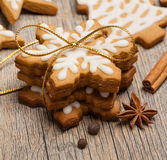 Christmas Cookies. Snowflake shaped Gingerbread cookies stacked and tied with a gold bow stock photography