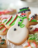 Christmas Cookies with Snowman. Delicious homemade christmas cookies with a snowman on white Stock Image