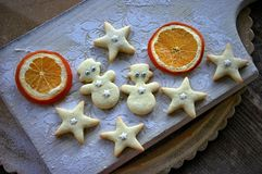 Christmas cookies. Snowmen and stars with orange Stock Photography