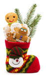 Christmas cookies in a sock Royalty Free Stock Photography