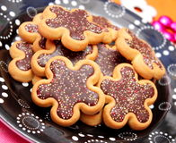 Christmas cookies. Some christmas cookies with chocolate and sprinkles stock photos