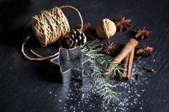 Christmas background. Christmas cookies and spices on black stone background Stock Photography