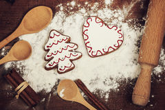 Christmas cookies, spices and flour on wooden chopping board Royalty Free Stock Photography