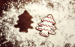 Christmas cookies, spices and flour on wooden chopping board Royalty Free Stock Photos