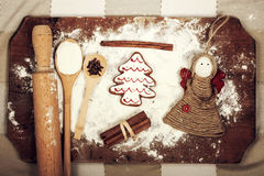 Christmas cookies, spices and flour on wooden chopping board Stock Image