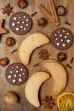 Christmas cookies, spices and nuts on wood, top view Stock Image