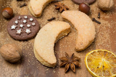Christmas cookies, spices and nuts on a wooden background Royalty Free Stock Image