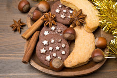 Christmas cookies, spices and nuts on a wooden plate Royalty Free Stock Image