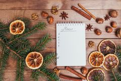 Christmas cookies, spices and recipe book. Food background. Vintage style picture. Christmas greeting card and food decor on brown wooden table with fir tree Royalty Free Stock Image