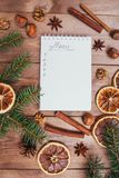 Christmas cookies, spices and recipe book. Food background. Vintage style picture. Christmas greeting card and food decor on brown wooden table with fir tree Royalty Free Stock Photography