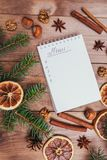 Christmas cookies, spices and recipe book. Food background. Vintage style picture. Christmas greeting card and food decor on brown wooden table with fir tree Stock Images