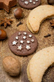 Christmas cookies, spices, sugar and nuts on a wooden background Stock Images