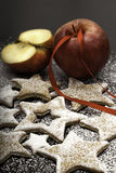 Christmas cookies sprinkled by sugar with red apples Stock Photo