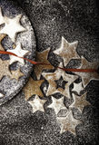 Christmas cookies sprinkled by white sugar with red ribbon Stock Photos
