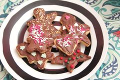 Christmas cookies with sprinkles. Some christmas cookies with chocolate and sprinkles of sugar Stock Photography