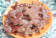 Christmas cookies with sprinkles. Some christmas cookies with chocolate and sprinkles of sugar Royalty Free Stock Image
