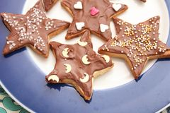 Christmas cookies with sprinkles. Some christmas cookies with chocolate and sprinkles of sugar Stock Photo