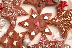 Christmas cookies with sprinkles. Some christmas cookies with chocolate and sprinkles of sugar Royalty Free Stock Images