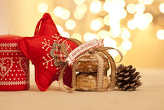 Christmas. Cookies, star, candle and pine cone Stock Photography
