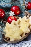 Christmas cookies in star shape, red apples and green fir Stock Images