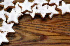 Christmas cookies, stars with cinnamon, on old wood, corner back Royalty Free Stock Photo