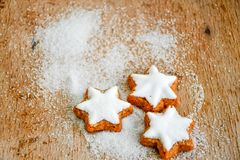 Christmas cookies. Sugar  and red ribbonmoody image of decorative food, simple composition. Card background Royalty Free Stock Photo