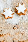 Christmas cookies. And sugar  on vintage wood background - dark moody image of decorative food, simple composition Stock Photo