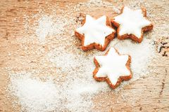 Christmas cookies. And sugar  on vintage wood background - dark moody image of decorative food, simple composition Royalty Free Stock Photo