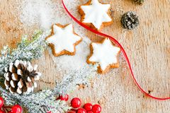 Christmas cookies. And sugar  on vintage wood background - dark moody image of decorative food, simple composition Stock Photos