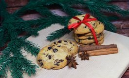 Christmas cookies. Sweet festive cookies with chocolate and red bow Royalty Free Stock Photo