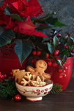 Christmas cookies on a table. Gingerbread, christmas cookies in a bowl and a festive decoir on wooden background Stock Photo