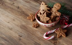 Christmas cookies on a table. Gingerbread and christmas cookies in a bowl on wooden background with a place for text Royalty Free Stock Photos