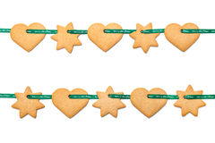 Christmas cookies tied with green ribbon Stock Photo