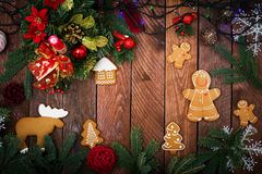 Christmas cookies and tinsel. On a dark wooden background. Top view. Flat lay Royalty Free Stock Images