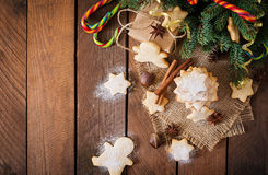 Christmas cookies and tinsel on a dark wooden background. Royalty Free Stock Photo