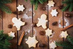 Christmas cookies and tinsel on a dark wooden background. Stock Photos