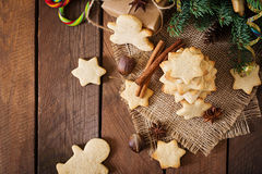 Christmas cookies and tinsel on a dark wooden background. Stock Images