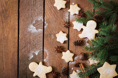Christmas cookies and tinsel on a dark wooden background. Royalty Free Stock Images
