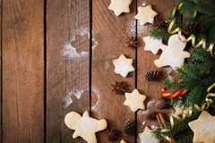 Christmas cookies and tinsel on a dark wooden background. Stock Image