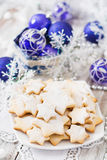 Christmas cookies and tinsel Royalty Free Stock Image