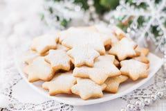 Christmas cookies and tinsel Stock Image