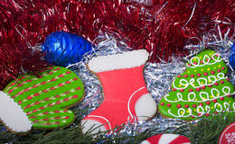 Christmas cookies in tinsel Royalty Free Stock Photo