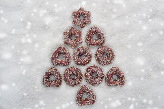 Christmas cookies tree made by cinnamon with snowy background Stock Photography