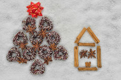 Christmas cookies tree near a house made by cinnamon Stock Image