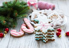 Christmas cookies and Christmas tree. On a old wooden table stock image