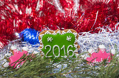 Christmas cookies 2016 with two pink crowns with red tinsel Stock Photos