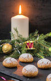 Christmas cookies with walnuts. Christmas cookies with nuts on a black background with the decoration of fir branches and Christmas Ornaments Royalty Free Stock Photos