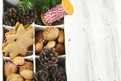 Christmas cookies, walnuts, nuts and pine cones in wooden box. Stock Image