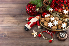 Christmas cookies and walnuts with vintage decorations Stock Photos