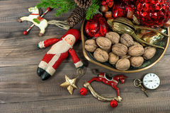 Christmas cookies and walnuts with vintage decorations Stock Photo